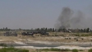 A convoy of armed vehicles is seen driving into Falluja