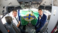 NI team captain Steven Davis with the captain of their flight.