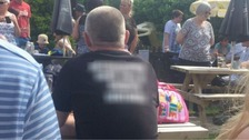 An inquiry was launchd after a photograph of a man wearing a T-shirt surfaced on social media