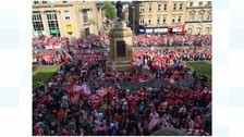 Town turns out to welcome home promotion winners