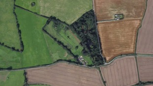Two killed after plane crashes in field