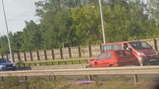 Four injured after pensioner drove WRONG way on M60