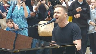 Gary Barlow surprises fans with impromptu performance at a shopping centre