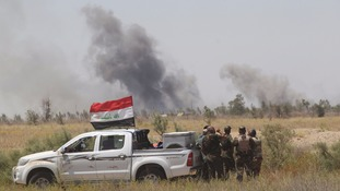 Smoke rises from clashes near Fallujah.