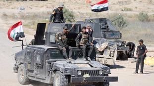 Iraqi security forces gather near Fallujah.