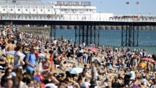 Packed beaches during the peak summer months