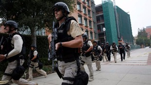 A Los Angeles Metro Police squad conducts a search on the University of California.