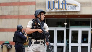 An armed officer on the university campus.