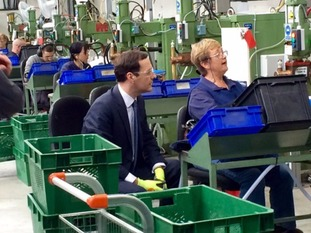 Osborne sported a pair of fluorescent gloves as he had a go at assembling parts