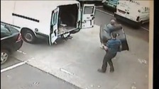 2 men attempt to load a stolen sofa into a van