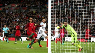 England 1-0 Portugal: Chris Smalling scores late winner as Three Lions struggle against ten men