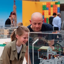 11-year-old Ellie Green admires a Lego masterpiece with Dad Phil Green.