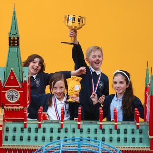 (L to R) Kieran, Lucy, Jacob and Ava, pupils from John Emmerson Batty Primary school, celebrate their Lego competition success behind the recreation of St Pancras station
