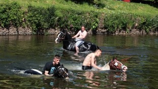 A horse is washed in the river Eden on the first day of the Horse Fair