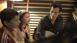 Eden Taverner-Wright sits alongside Mark Ronson in the recording studio.