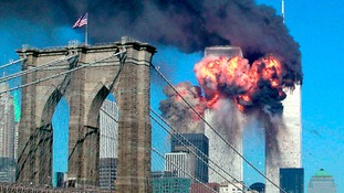 The second tower of the World Trade Center explodes into flames after being hit by a airplane.