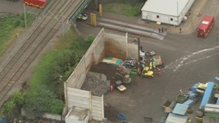 The scene of yesterday's wall collapse at a recycling centre, killing five workers.