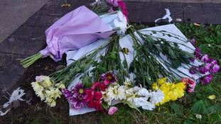 Flowers left at the scene of the incident