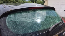 A car window was smashed by tiles knocked from the roof.