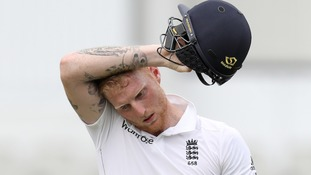 Ben Stokes leaves the field injured.