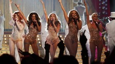 Girls Aloud pictured on stage in 2009