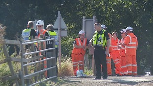 Police and Network Rail investigators on the scene.