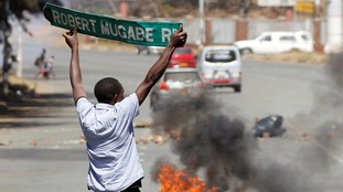 Zimbabwe opposition leaders forced to flee anti-Mugabe rally after being teargassed