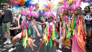 Dancers perform during the Children's Day parade at the Notting Hill Carnival.