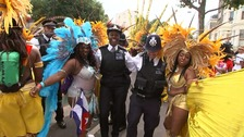 Top cop joins police officers dancing with Notting Hill Carnival goers.
