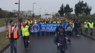 People taking part in the protest march near the A16 towards Calais.