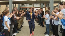 The gold-medallist returned to a hero's welcome