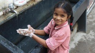 Indian girl washing her hands