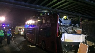Tottenham bus crashes into railway bridge injuring more than 20 people