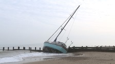 The yacht is stuck on the groynes at Happisburgh.