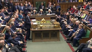 Philip Hammond addresses MPs at the House of Commons.