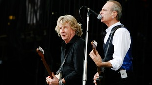 Rick Parfitt (L) and Francis Rossi perform at the Glastonbury Festival in 2009.