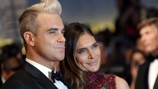 Robbie Williams and his wife Ayda Field.