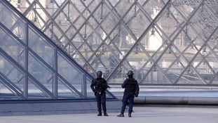 Armed members of the security services outside the Louvre.