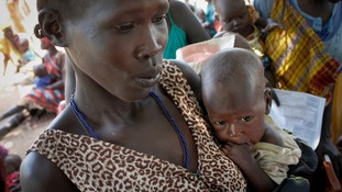 A mother holds her malnourished daughter in South Sudan, October 2016.