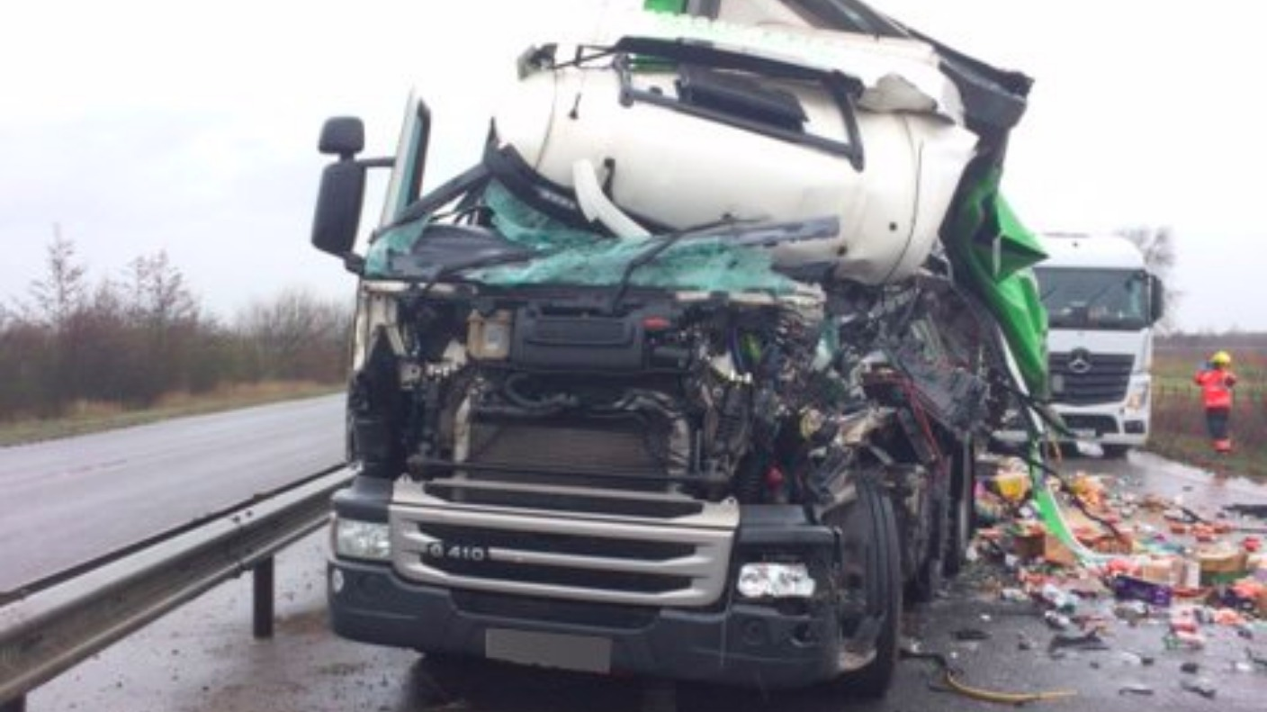 driver cut from lorry after crash closes a47 for 90