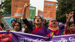 Bangladeshi activists and garment workers attend a rally in in Dhaka, Bangladesh