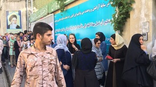Iranians queue to cast their votes in the crucial presidential elections.