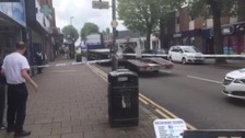 Road safety campaigners want to ban lorries from driving down a busy shopping street.