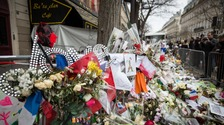 Flowers, cards and pictures were left outside the Bataclan concert hall after the attack.