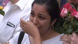 One mourner breaks down in tears.