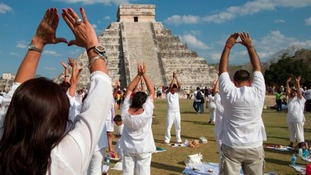 Tourists visit the Mayan pyramid in Chichen Itza, Mexico