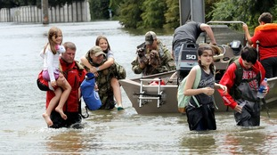 Thousands of people were rescued by emergency services.