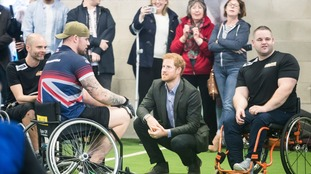 Prince Harry meets Invictus Games gold medalist Greg Dunnings at the Sir Tom Finney Soccer Development Centre