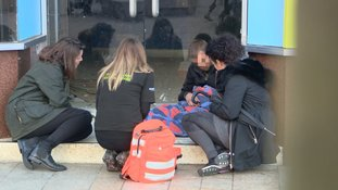 Volunteers check on a homeless person