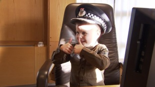 Jayden the boy who's been a cop for a day